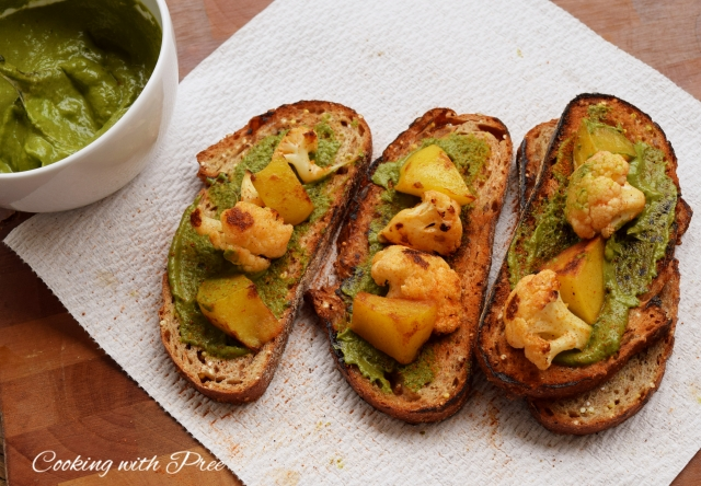 roasted veg open sadwich with avacado cilantro green sauce